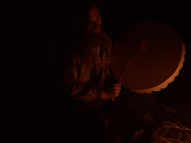 beating a shaman drum