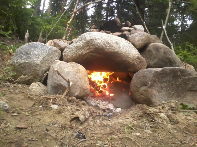Heating up the primitive sauna stove