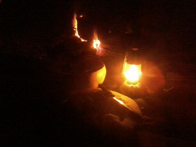 working in the light of an oil lantern