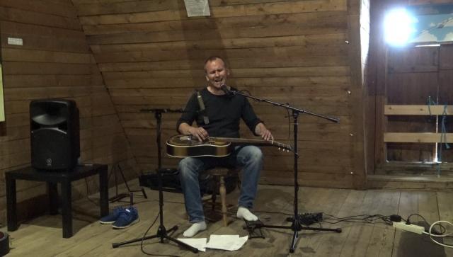 Singer-songwriter Mika Jaakkola plays lap steel guitar