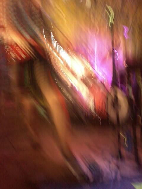 Litku Klemetti playing balalaika. A picture I took while dancing. No filter, no photoshop.