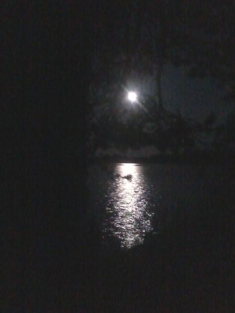The moon over Lake Paloselkä, seen from the islet