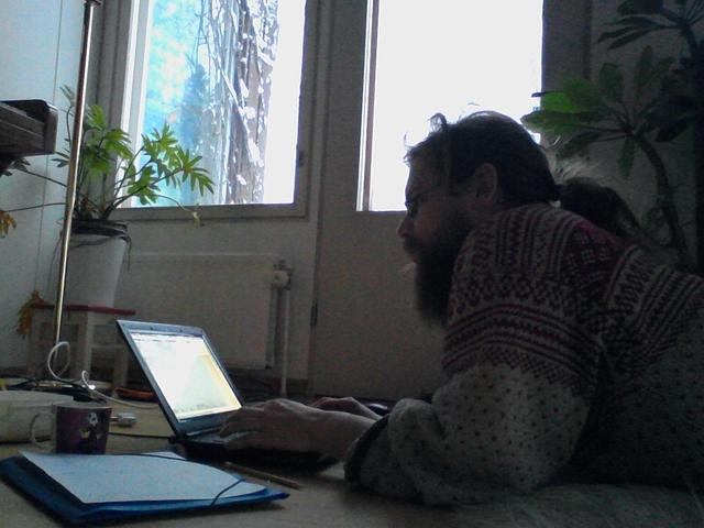 Coding on the floor of my friends' living room.
