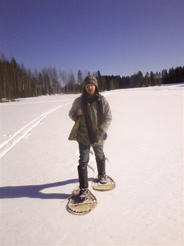 Sami walking with his snowshoes